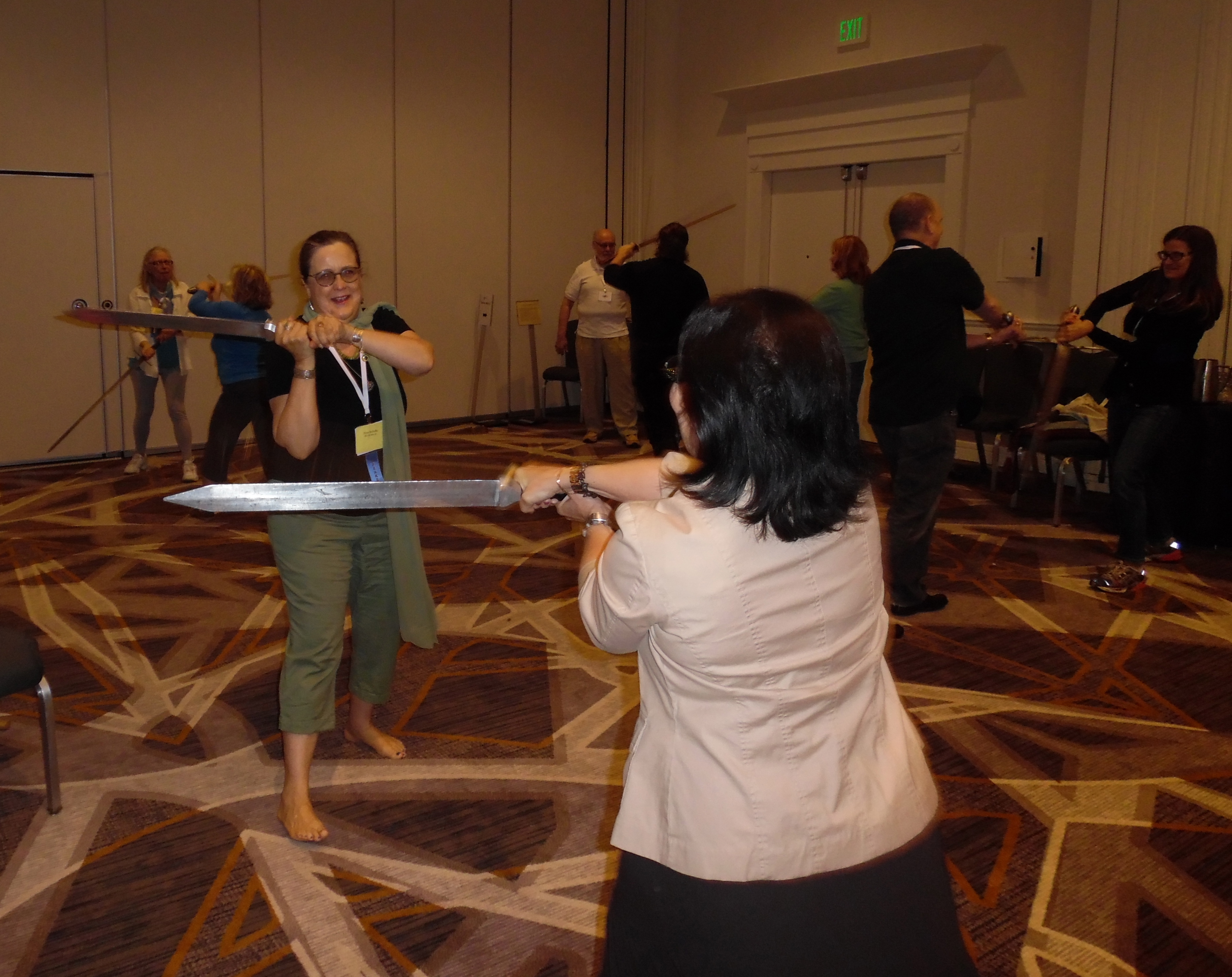 Practicing with a broadsword at David Blixt's swordplay workshop.